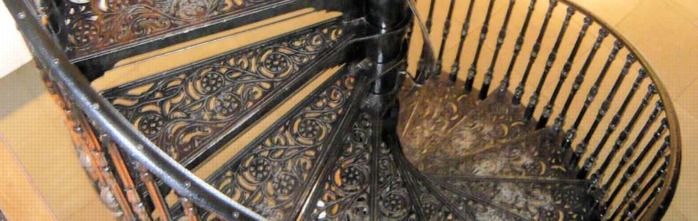 Cast Iron Modular Spiral Staircase with floral pattern Tread and tulip style Balustrading