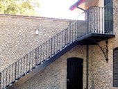 Cast Iron Straight Staircase and balcony with galvanised Stair Treads