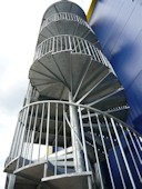 Multiple flight Spiral Fire Escape with Galvanised steel tread and close bar balustrading