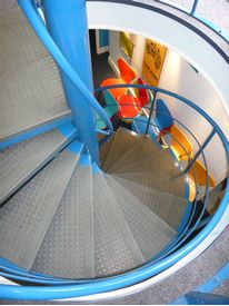 Powder coated spiral stairs with studded rubber treads and nosings