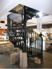 Cast iron spiral staircase in restaurant
