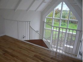 Matching gallery balustrade to spiral staircase