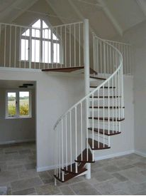Mild steel domestic spiral staircase with hardwood treads