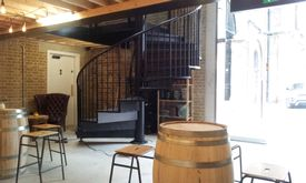 Black powder coated spiral staircase giving access to the upper floor of a pub in Royal Arsenal, Woolwich