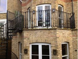 Matching cast iron balustrade to first floor terrace area for Hampstead property