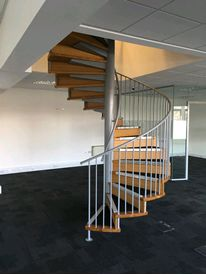 Spiral staircase to office conversion with Iroko hardwood treads and risers and powder coated balustrades