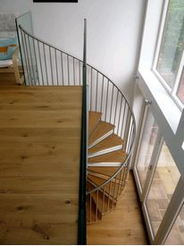 Domestic spiral staircase with oak treads and stainless steel balustrades