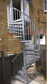 Domestic spiral staircase serving first floor flat in Wimbledon