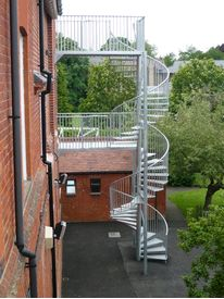 Spiral fire escape with extended landings