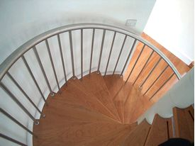 Domestic spiral staircase with hardwood treads and stainless steel balustrades