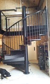 Spiral staircase to first floor terrace with durbar plate treads and closed risers