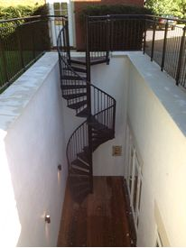 Powder coated access spiral staircase from basement area to garden level
