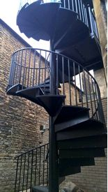 Spiral fire escape staircase with black powder coat finish to meeting room at Stamford Town Hall