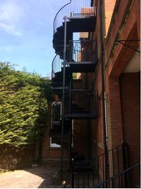 Multiple flight spiral fire escape finished in black
