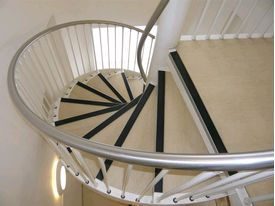 Bespoke spiral stairs with stainless steel handrail